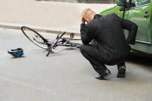 Cyclist hit by car door accident claims